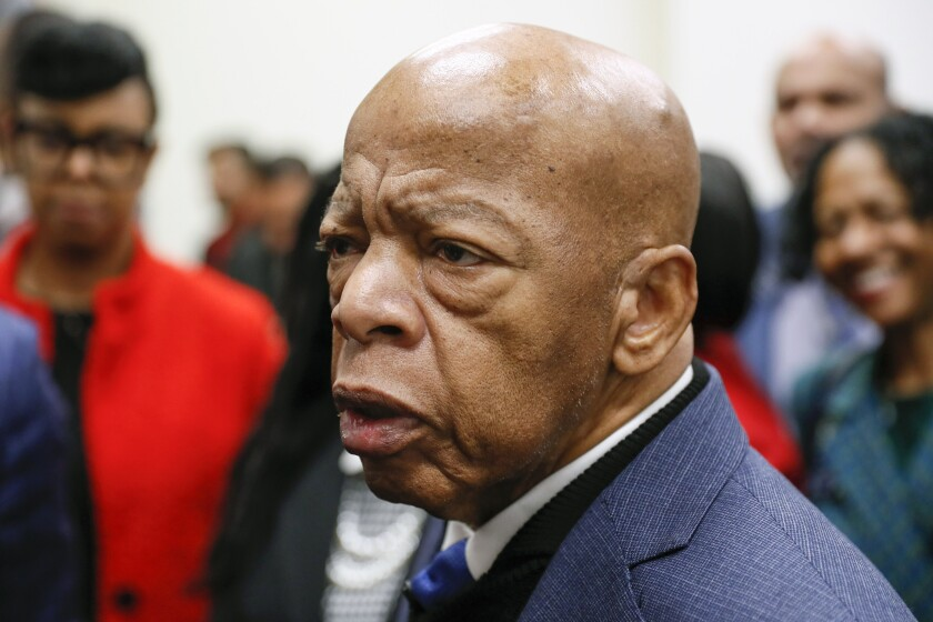 """FILE - In this March 2, 2020 file photo, Congressman John Lewis talks with media members after signing paperwork to qualify for reelection to his District 5 seat in Atlanta. Lewis said Thursday, June 4, that the video of George Floyd's death at the hands of police in Minnesota """"made me cry."""" """"I kept saying to myself: How many more? How many young black men will be murdered?"""" the Georgia congressman said on CBS. (Bob Andres/Atlanta Journal-Constitution via AP)"""