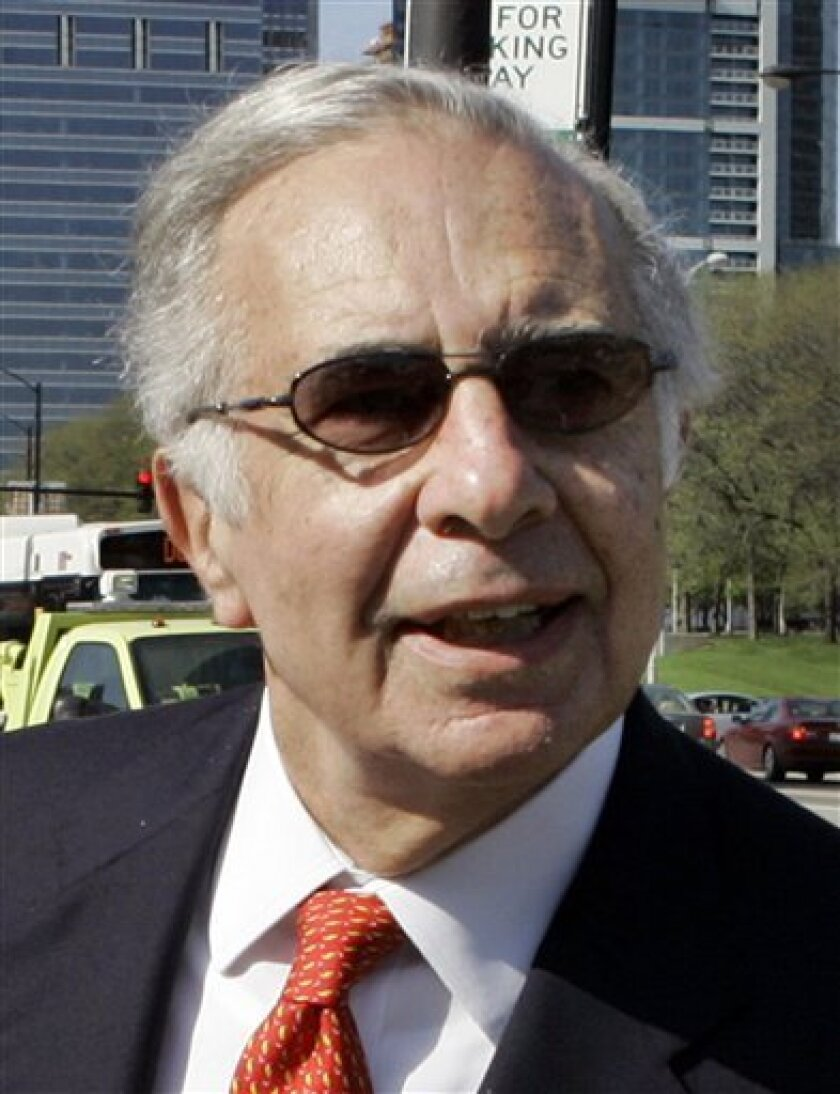 FILE - In this May 7, 2007 file photo, billionaire financier Carl Icahn is seen as he arrives at the Motorola annual meeting in Chicago. Icahn said Tuesday, June 1, 2010, he will again extend his offer to buy Lions Gate Entertainment Corp., and removed the condition of the offer requiring at least 50.1 percent of shares to be tendered.(AP Photo/Charles Rex Arbogast, File)