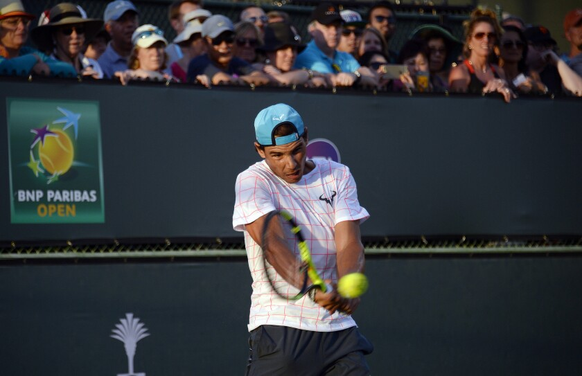 Rafael Nadal practices in front of a large crowd Thursday at Indian Wells.