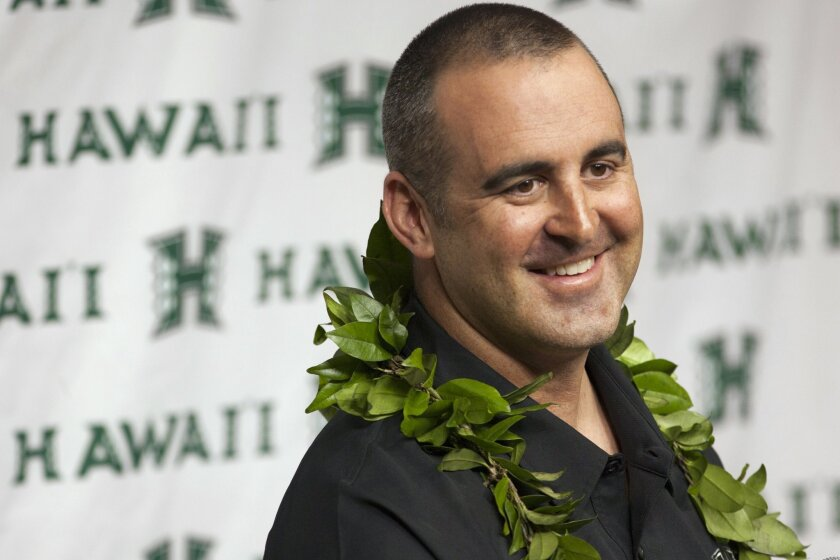 New Hawaii head coach Nick Rolovich speaks during a news conference Monday, Nov. 30, 2015, in Honolulu. At his first news conference as head coach, Rolovich said he plans to coach with aloha, encouraging his athletes to play for one another and do what's right for their community. (AP Photo/Caleb Jones)