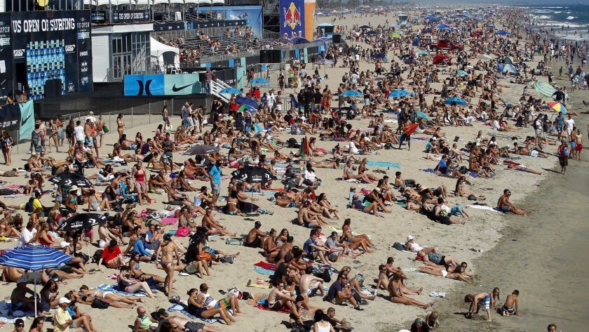 Thousands will crowd the shoreline Saturday to take in the scene during the U.S. Open of Surfing hel