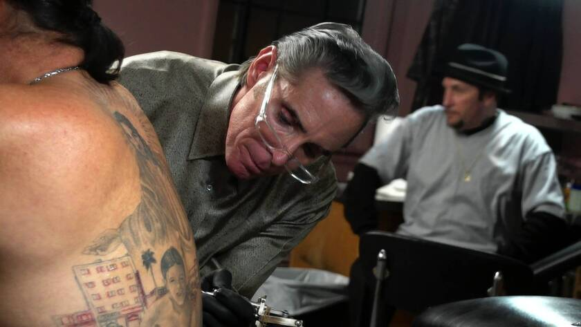 "Tattoo artist Mark Mahoney works on Danny Trejos' back in ""Tattoo Nation."""