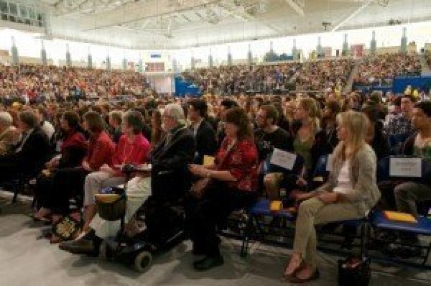 As many as 4,500 people gathered at RIMAC Arena April 18 to hear the Dalai Lama discuss global warming with UCSD professors Veerabhadran Ramanathan and Richard Somerville. Photo/Carol Sonstein