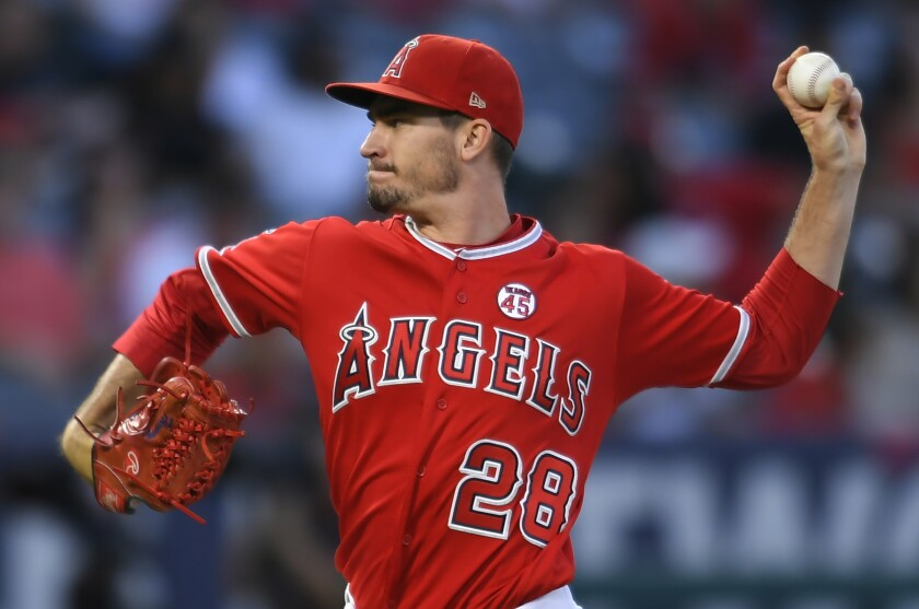 Angels pitcher Andrew Heaney delivers against the Texas Rangers in August.