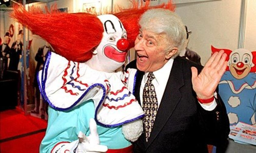 Harmon with a Bozo performer in 1996 at the National Assn. of Television Program Executives convention in Las Vegas.