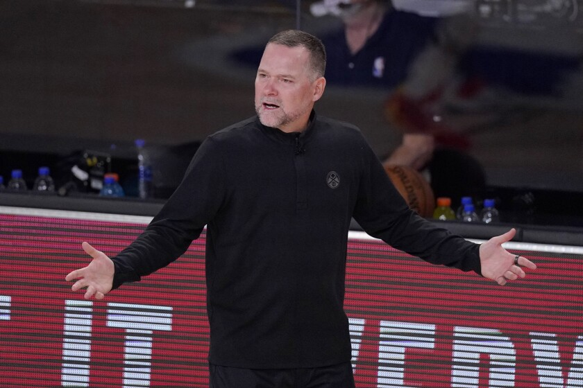 Denver Nuggets head coach Michael Malone gestures in the first half of an NBA conference semifinal playoff basketball game Thursday, Sept 3, 2020, in Lake Buena Vista Fla. (AP Photo/Mark J. Terrill)