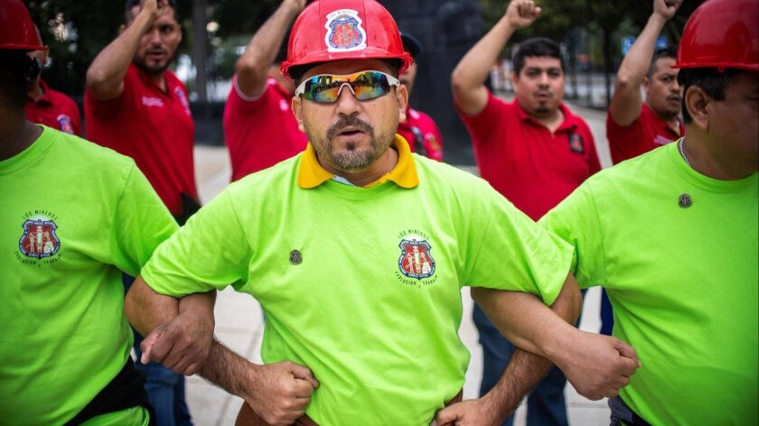 Members of a Mexican miners union take part in a demonstration in support of Sen. Napoleon Gomez Urrutia.