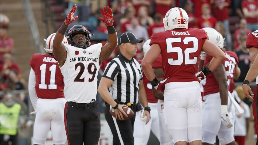 San Diego State running back Juwan Washington celebrates after scoring a 4-yard touchdown against Stanford during the first half of an NCAA college football game Friday, Aug. 31, 2018, in Stanford, Cali