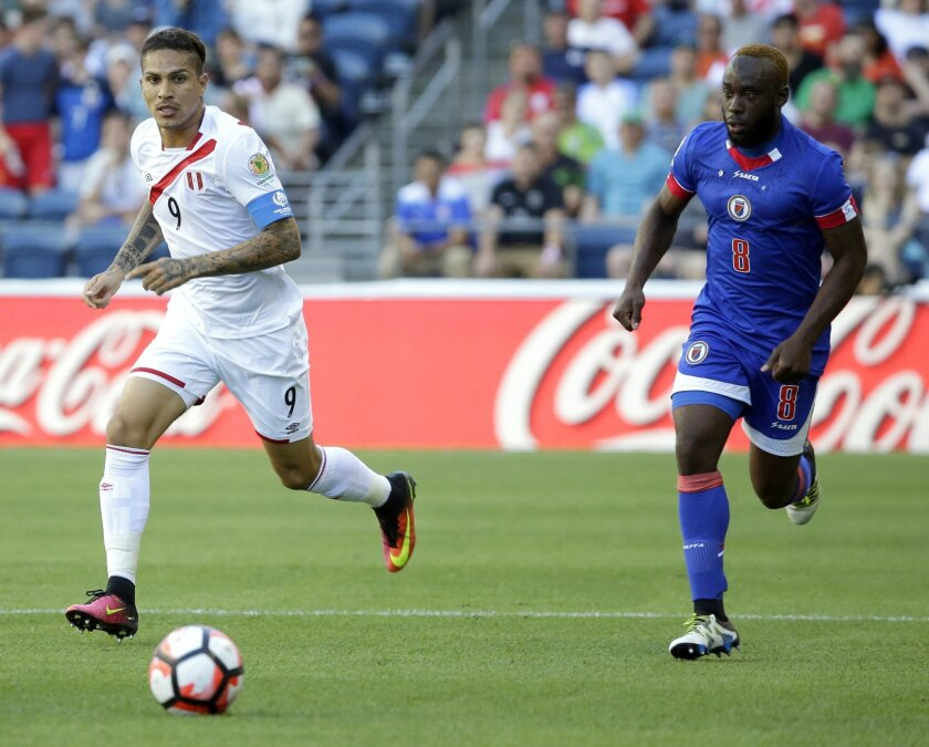 Peru forward Paolo Guerrero (9) eyes the ball as Haiti's Reginal Goreux, right, moves in during the first half of a Copa America Centenario soccer match, Saturday, June 4, 2016, in Seattle. (AP Photo/Ted S. Warren)