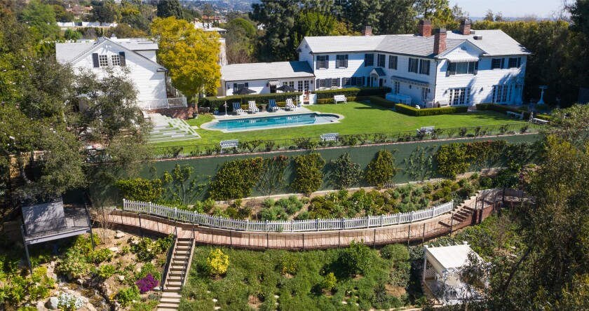 The cul-de-sac compound includes a 1930s home, two-story guesthouse, swimming pool and tiered garden.
