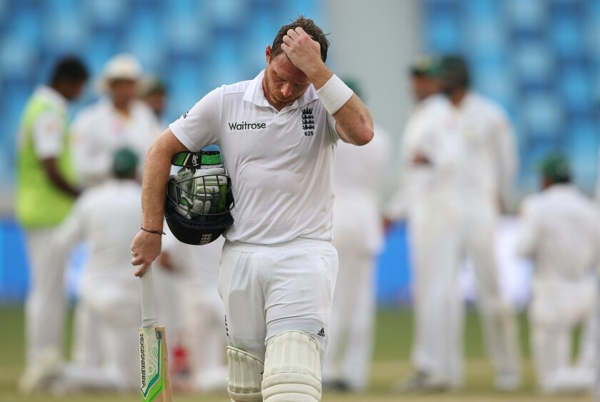 FILE - This is a Sunday, Oct. 25, 2015 file photo of England's Ian Bell as he leaves the pitch after he was dismissed during the Pakistan and England Test match at the Dubai International Stadium in Dubai, United Arab Emirates. Ian Bell was dropped by England for the upcoming cricket tour to South Africa on Thursday Nov. 19, 2015 after a poor run of form for the test team, potentially spelling the end of the 33-year-old batsman's international career. (AP Photo/Kamran Jebreili, File)