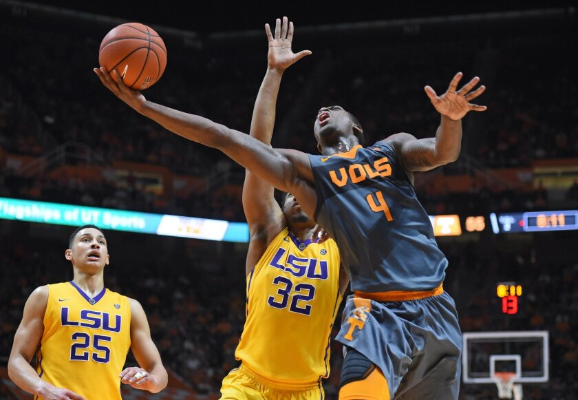 Tennessee forward Armani Moore (4) gets to the hoop with a layup past LSU forward Craig Victor II (32) as LSU forward Ben Simmons (25) looks on during an NCAA college basketball game in Knoxville, Tenn., on Saturday, Feb. 20, 2016. Tennessee won 81-65. (Adam Lau/Knoxville News Sentinel via AP) MANDATORY CREDIT