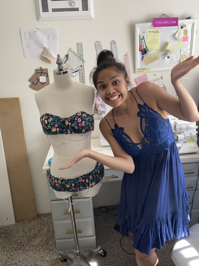 San Diego fashion designer Leizl Totaram with her handmade face masks, fashioned as a makeshift swimsuit
