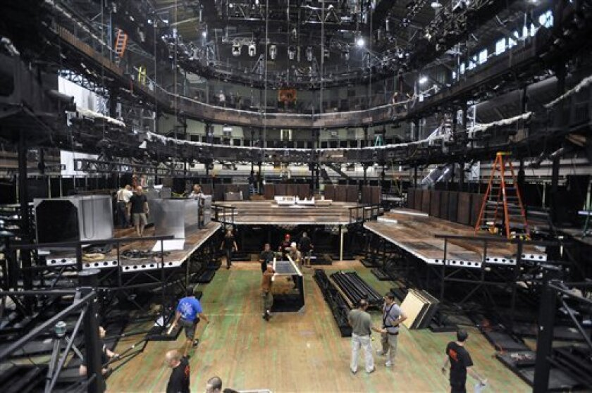 """In this June 23, 2011 photo released by Lincoln Center Festival, workers construct a full-scale replica of the Royal Shakespeare Theatre in Stratford-upon-Avon at the Park Avenue Armory in New York  for five Shakespeare plays, """"As You Like It,"""" """"Julius Caesar,"""" """"King Lear,"""" """"Romeo and Juliet,"""" and"""