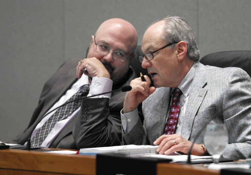 CalPERS President Rob Feckner, left, confers with then-Vice President George Diehr during a 2011 meeting. Feckner was reelected to an 11th term as president.