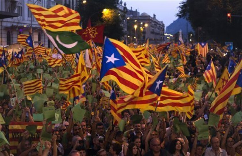 """FILE - Demonstrators wave Catalan flags during a protest rally in Barcelona , Spain, in this Tuesday, Sept. 11, 2012 file photo. Thousands of people demonstrated in Barcelona on Tuesday demanding independence for Catalonia, on the Catalonia region's 'National Day"""". On Thursday, regional lawmakers voted to hold a referendum for Catalonia's seven million citizens to decide whether they want to break away from Spain. The Spanish government says that the referendum would be unconstitutional. And it's unclear if the """"Yes"""" vote would win — even in these restless times. But it looks more likely than ever that Catalonia may ask to go its own way. (AP Photo/Emilio Morenatti, File)"""