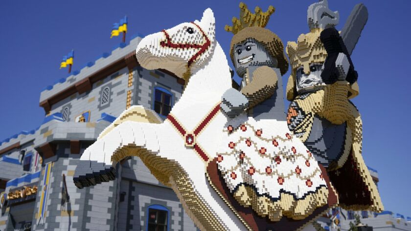 A statue made from Legos is at the front entrance to Legoland's Castle Hotel in Carlsbad.