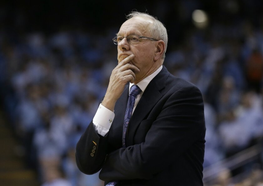 FILE - In this Jan. 26, 2015, file photo, Syracuse coach Jim Boeheim watches during his team's NCAA college basketball game against North Carolina in Chapel Hill, N.C. Syracuse was put on probation for five years and Boeheim got a nine-game suspension for violations that included failure to adhere