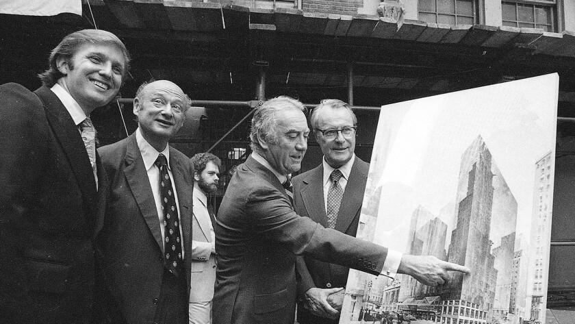 A young Donald Trump, left, pictured June 28, 1978 alongside Mayor Ed Koch of New York; New York Gov. Hugh Careyand Robert T. Dormer, executive vice president of the Urban Development Corp.
