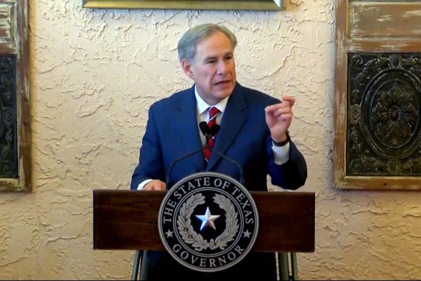 Texas Gov. Greg Abbott speaks from a lectern.