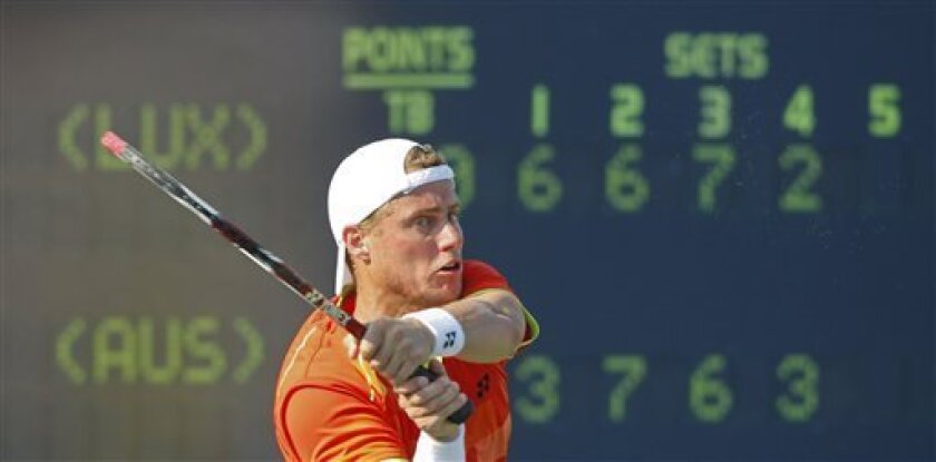 Australia's Lleyton Hewitt returns a shot to  Gilles Miller of Luxemborg, in the third round of play at the 2012 US Open tennis tournament,  Friday, Aug. 31, 2012, in New York. (AP Photo/Mel C. Evans)