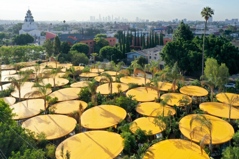 An overhead view of the Second Home garden studios shows a series of elliptical yellow roofs surrounded by plants.