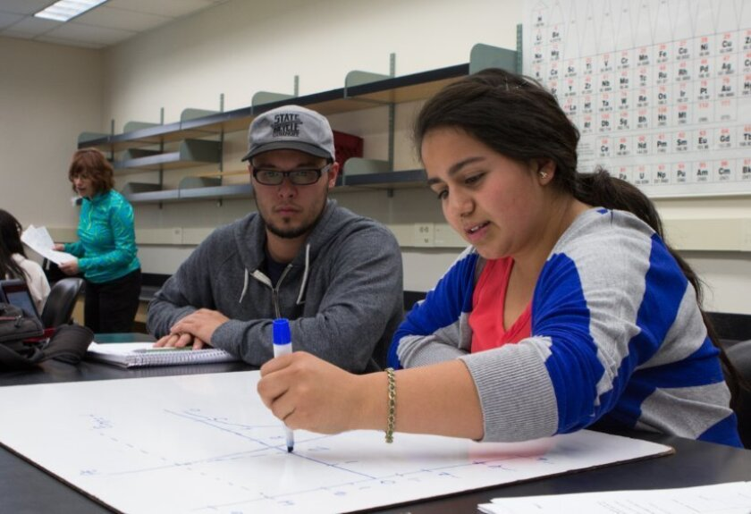 Students work on a physics assignment at Cal State San Marcos.