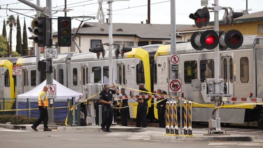 A tent covers the body of a pedestrian who was struck and killed by a Metro Expo Line train Monday.