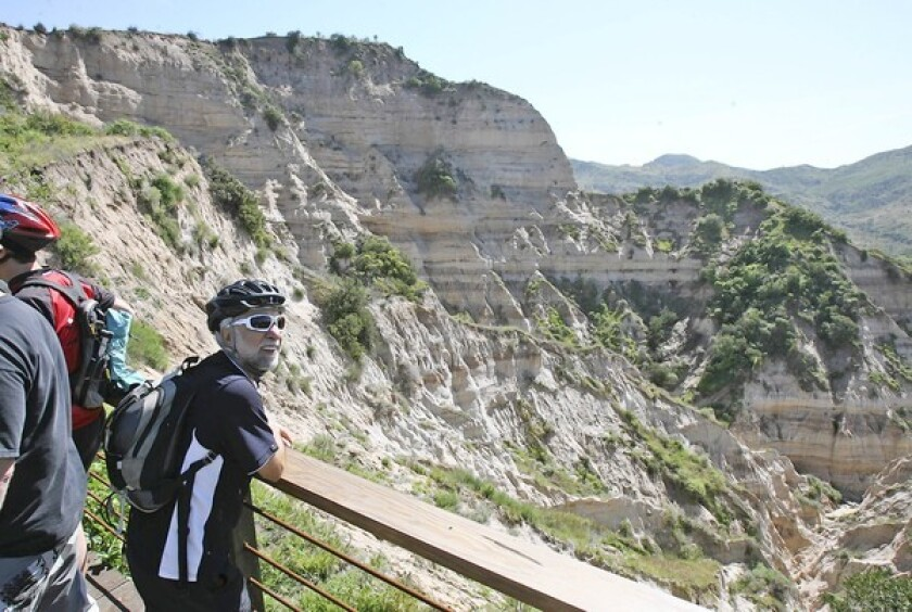 "Mountain biker Mansoor Vakili takes in the expansive view of ""The Sinks"" from the new viewing deck at Limestone Canyon, which was dedicated by officials from Irvine Ranch Conservancy and OC Parks on Friday."
