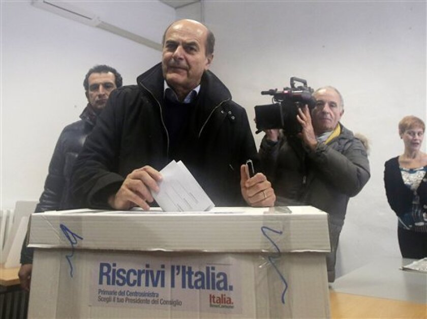 """Pier Luigi Bersani, leader of the center-left Democratic Party, casts his vote during a primary runoff, in Piacenza, Italy, Sunday, Dec. 2, 2012. Italians are choosing a center-left candidate for premier for elections early next year, an important primary runoff given the main party is ahead in the polls against a center-right camp in utter chaos over whether Silvio Berlusconi will run again. Sunday's runoff pits veteran center-left leader Pier Luigi Bersani, 61, against the 37-year-old mayor of Florence, Matteo Renzi, not shown, who has campaigned on an Obama-style """"Let's change Italy now"""" mantra. (AP Photo/Antonio Calanni)"""