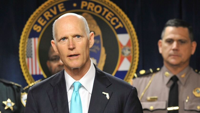 Flanked by area law enforcement and city leaders Florida Governor Rick Scott made a stop at the Jack