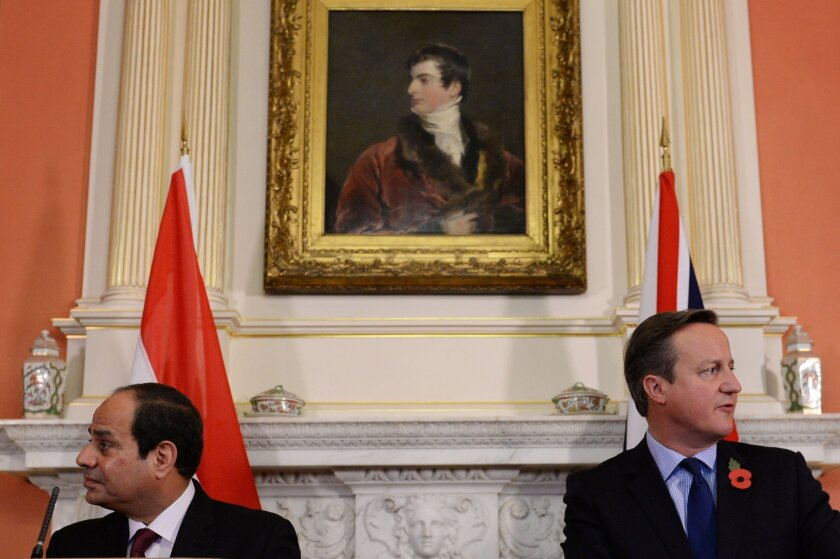 Britain's Prime Minister David Cameron, right,  holds a news conference with Egyptian President Abdel Fattah el-Sissi, Thursday, Nov. 5, 2015, at 10 Downing Street in London, following their meeting. The Egyptian president is on a three day visit to the country.  (Stefan Rousseau/Pool Photo via AP)