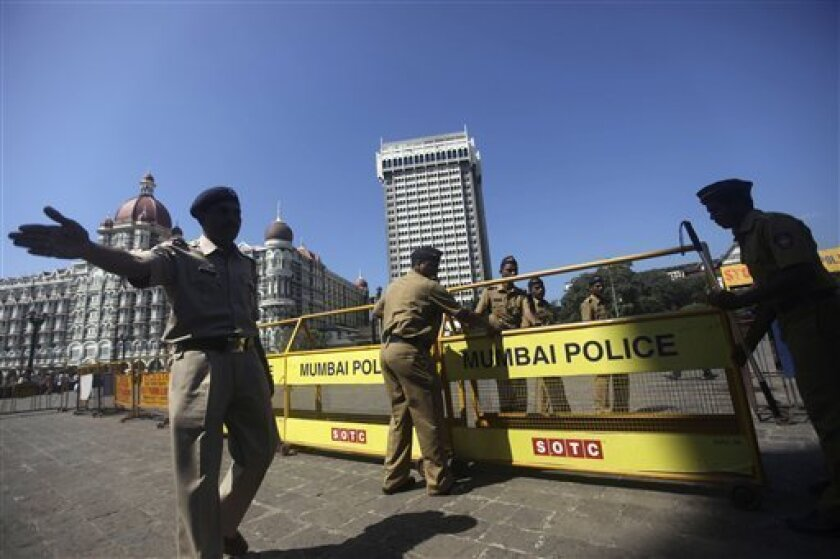 Indian policemen set up security barricades outside the Taj Mahal hotel in Mumbai, India, Thursday, Nov. 4, 2010. President Barack Obama is scheduled to stay at the hotel on Nov. 6. The 107-year-old hotel reopened for business in August, nearly two years after it was attacked by terrorists in 2008.(AP Photo/Rafiq Maqbool)