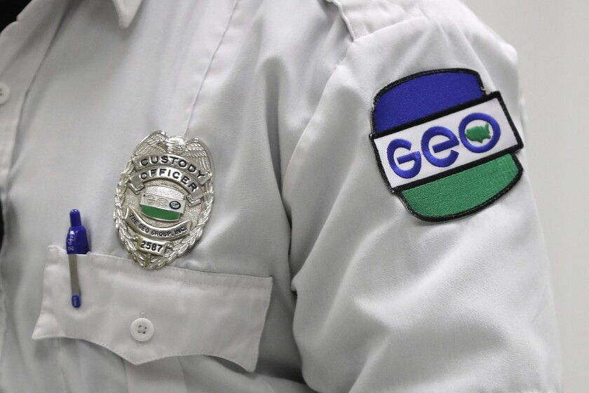 A patch is shown on the uniform of a guard with the GEO Group