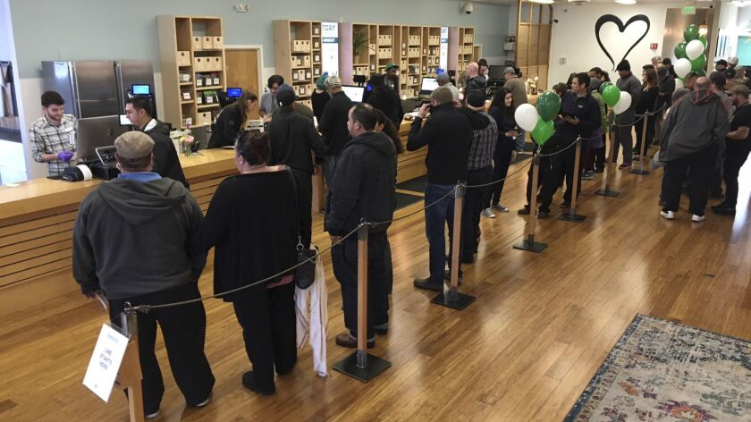 FILE - In this Jan. 4, 2018, file photo, customers line up inside the Harborside cannabis dispensary