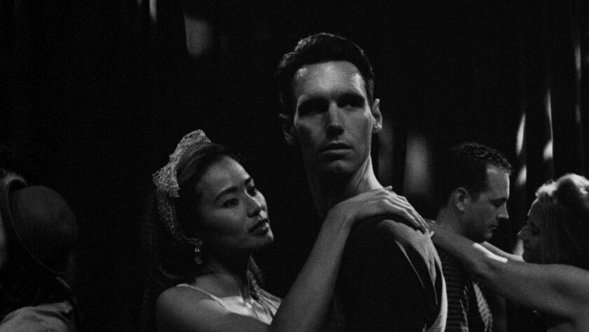 "(L-R) - Jamie Chung and Cory Michael Smith in a scene from the movie ""1985."" Credit: Hutch H. /"