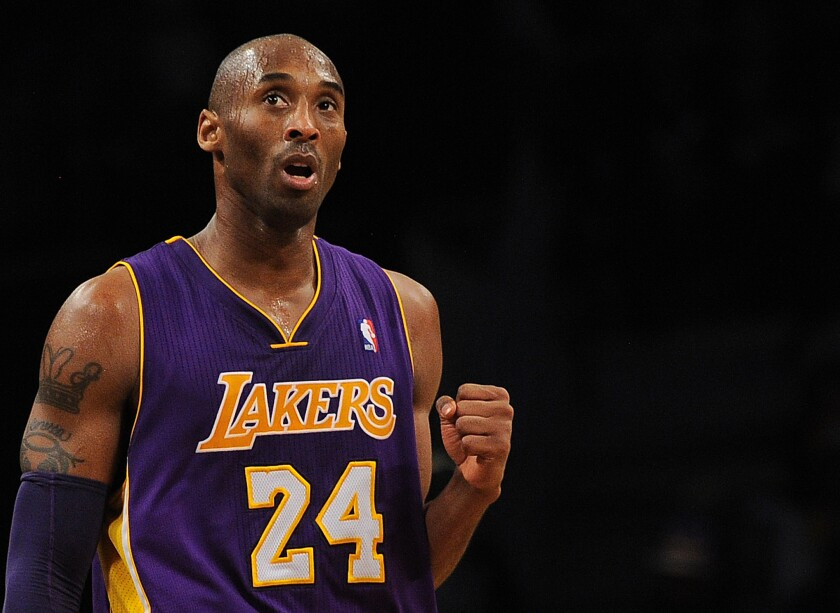 Los Angeles Lakers Kobe Bryant reacts while playing against the Brooklyn Nets during their NBA game at the Barclays Center in the Brooklyn borough of New York City, February 5, 2013.