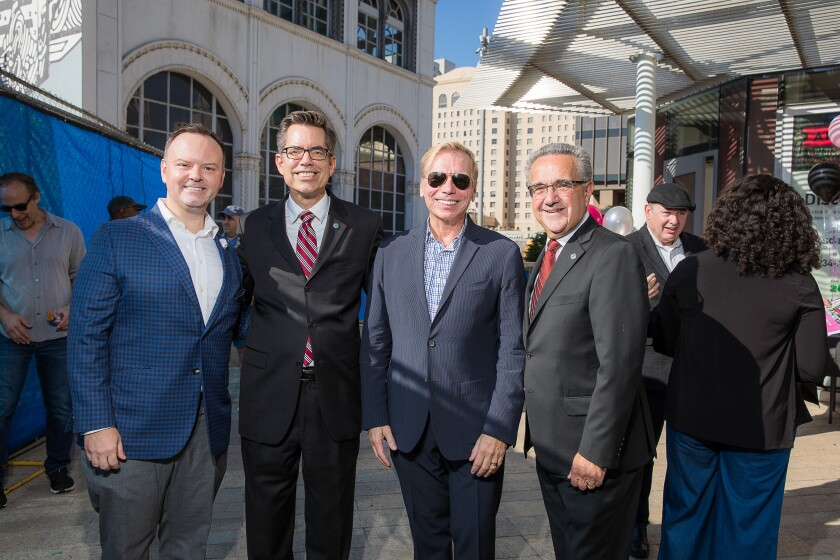 Dignitaries pose for a photo at the ArtsTix booth at Horton Plaza.