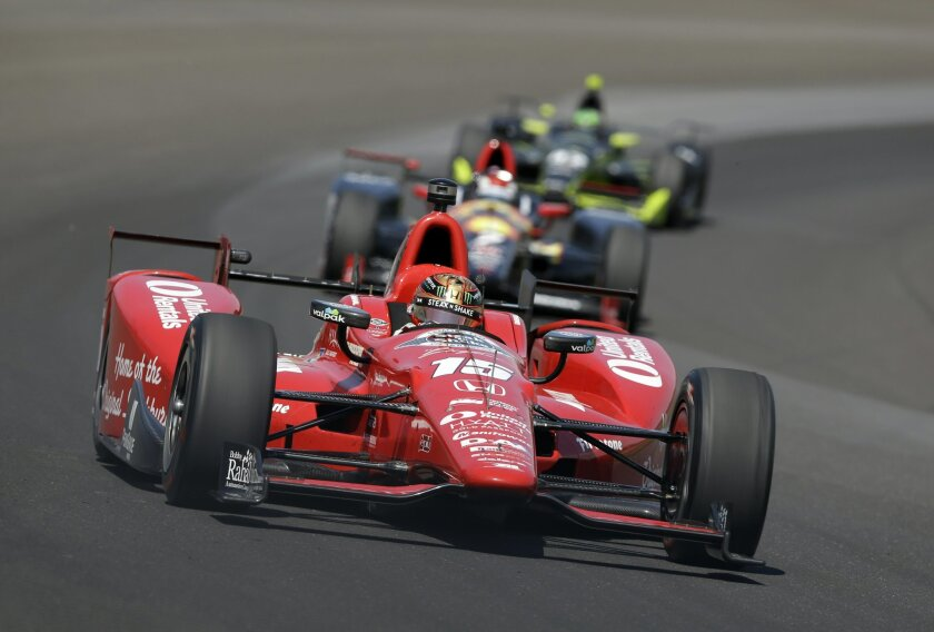 Graham Rahal drives through turn one during the final practice session for the Indianapolis 500 auto race at Indianapolis Motor Speedway in Indianapolis, Friday, May 27, 2016. (AP Photo/Michael Conroy)