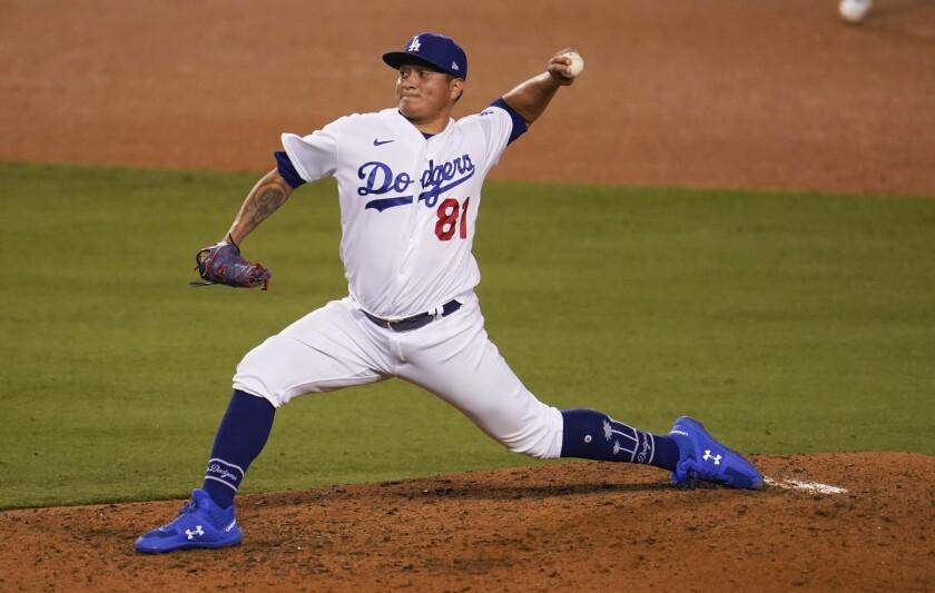 Los Angeles Dodgers relief pitcher Victor Gonzalez works against the Arizona Diamondbacks.
