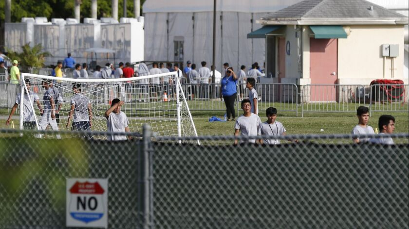 Immigrant children play outside a former Job Corps site that now houses them, Monday, June 18, 2018,