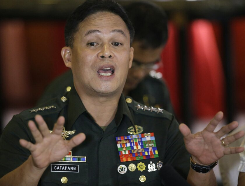 """Philippine Armed Forces Chief Gen. Gregorio Pio Catapang gestures as he talks about """"the greatest escape"""" of Philippine troops deployed as UN Peacekeepers in the Golan Heights while being besieged by a rebel faction in Syria, during a forum with foreign correspondents Tuesday, Sept. 2, 2014 at suburban Mandaluyong city, east of Manila, Philippines. Catapang said that a U.N. peacekeeping commander in the Golan Heights should be investigated for allegedly asking Filipino troops to surrender to Syrian rebels who had attacked and surrounded their camp. Catapang further said he advised the 40 Filipino peacekeepers not to lay down their arms, and they defied the U.N. peacekeeping commander's order. Instead, they staged a daring escape from the Golan camp over the weekend, ending a tense, dayslong standoff.(AP Photo/Bullit Marquez)"""