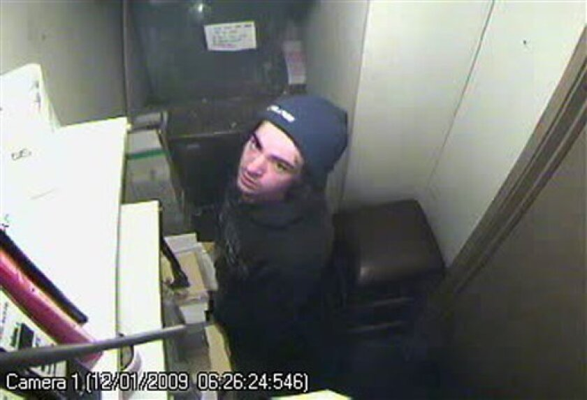 Provided by the Queenstown Police, this is a closed-circuit television image of a burglar attempting to rob the Franklin Tavern in the tourist town of Queenstown early Monday, Jan. 12, 2009. After nearly an hour in the cramped space, the burglar removed his balaclava and gloves and looked around. T