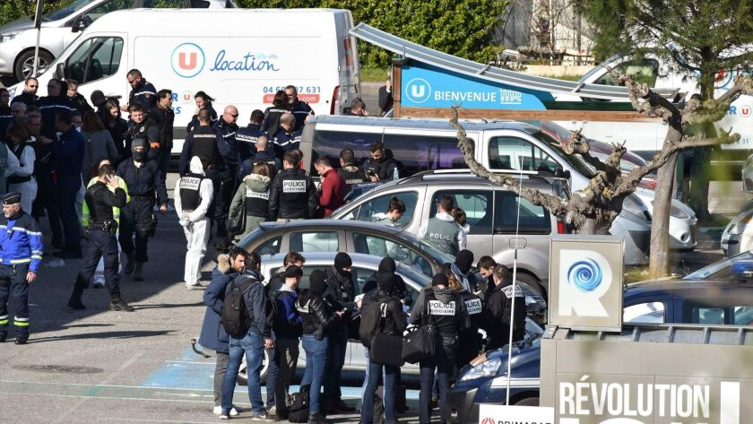 The scene outside a supermarket in Trebes, France, where a gunman was killed after taking hostages.