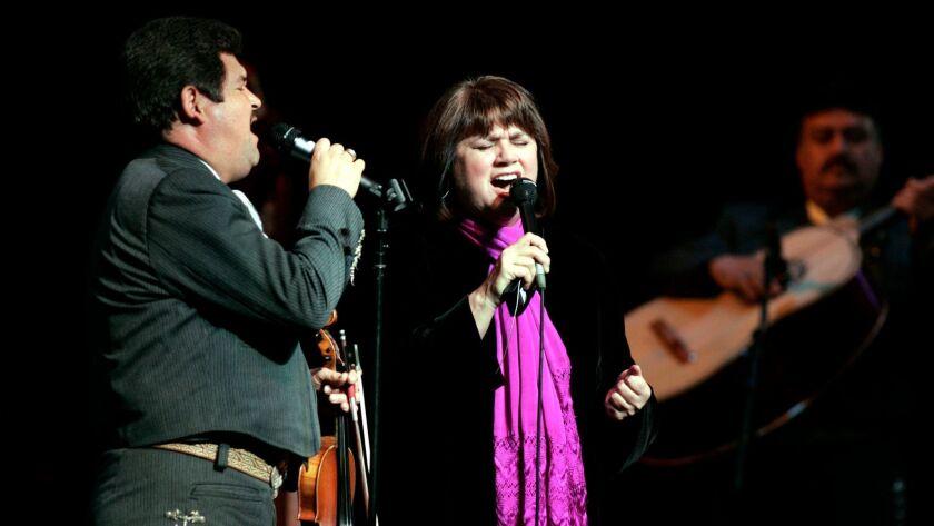 "Linda Ronstadt with Jesus ""Chuy"" Guzman, left, at the Orange County Performing Arts Center in Costa Mesa on Dec. 7, 2005."