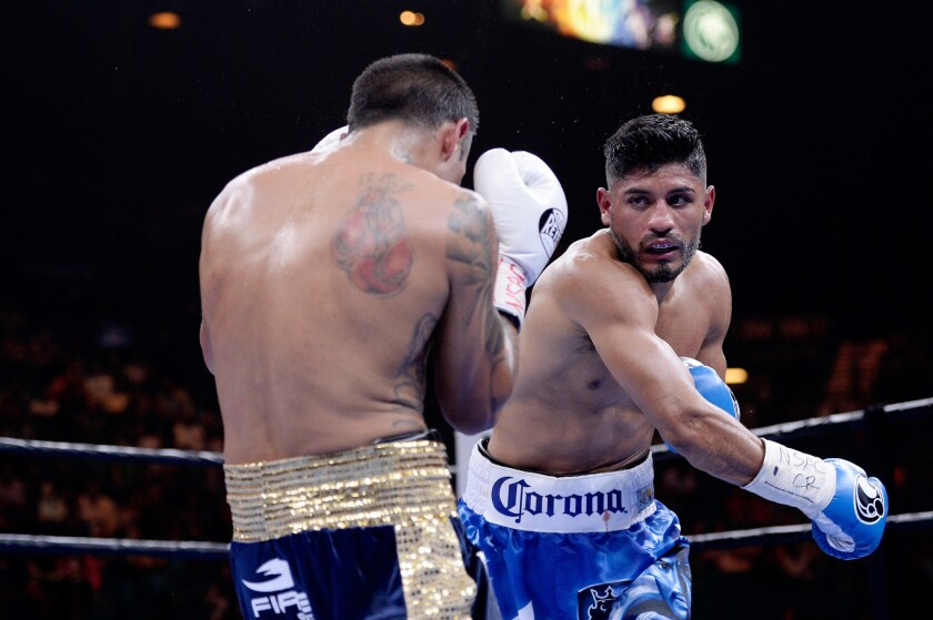 Abner Mares, right, fights Arturo Reyes on March 7 in Las Vegas.