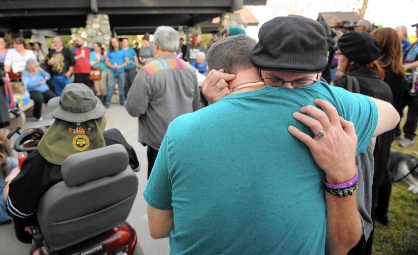 Ryan Reyes, boyfriend of San Bernardino shooting victim Daniel Kaufman, gets a hug during a memorial in Irwindale in December.