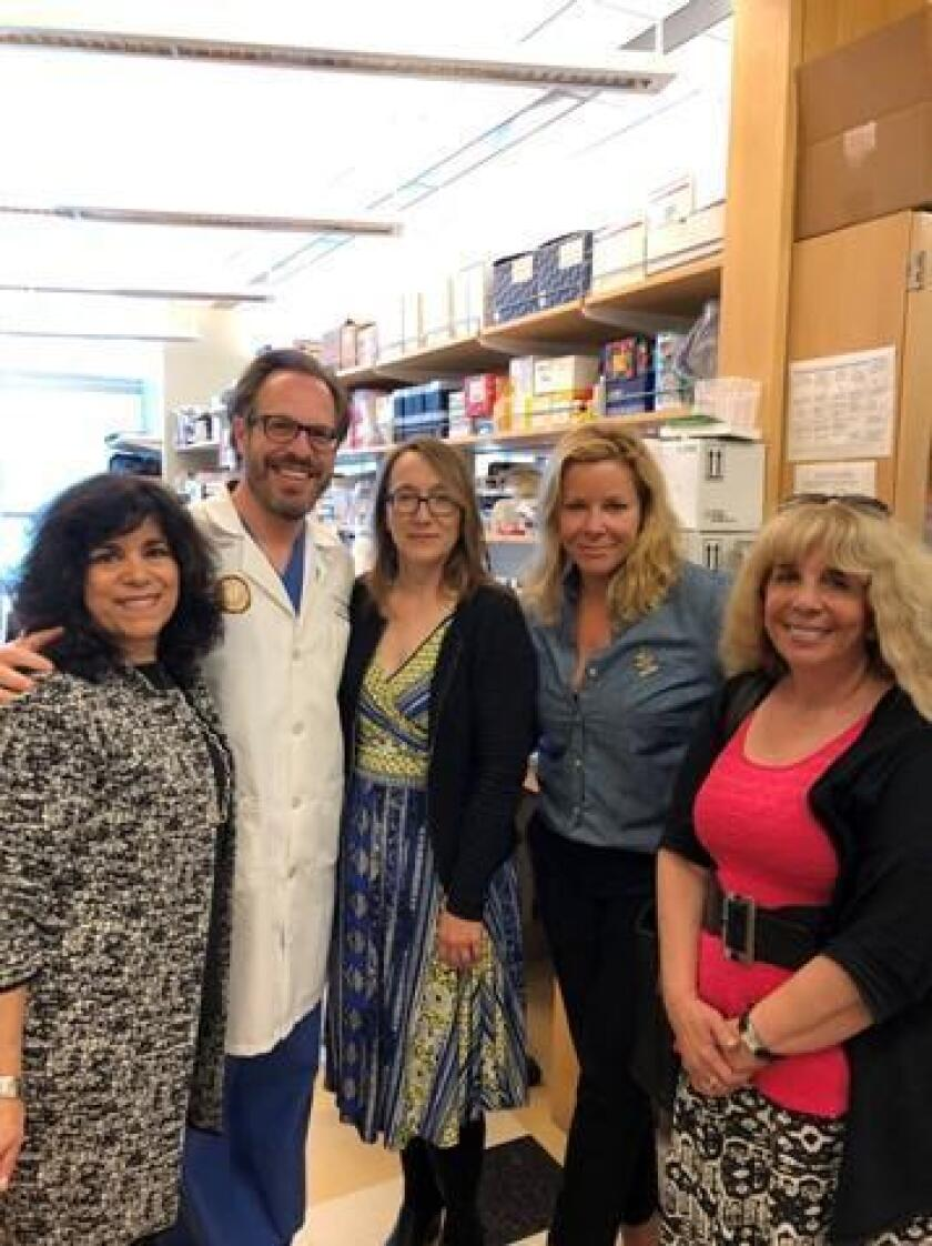 Global Genes representatives tour Dr. Jason Sicklick's Research Laboratory. From left: Debra Melikian, Dr. Jason Sicklick, Dr. Maureen McArthur Hart, Nicole Boice and Dr. Razelle Kurzrock.