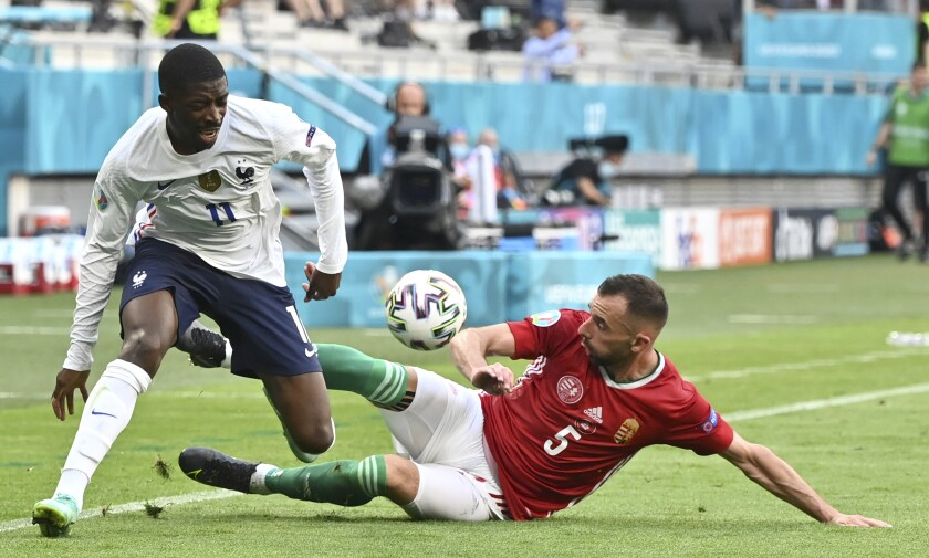 Hungary's Attila Fiola, right, challenges France's Ousmane Dembele during the Euro 2020 soccer championship group F match between Hungary and France at the Ferenc Puskas stadium in Budapest, Hungary Saturday, June 19, 2021. (Tibor Illyes/Pool via AP)