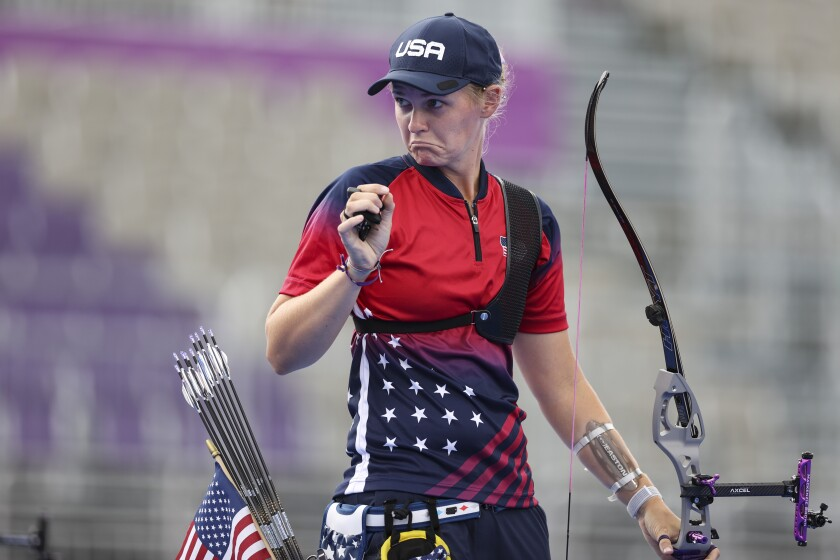 Chula Vista's Mackenzie Brown seems to indicate how close her arrow was to winning her semifinal match at Tokyo Olympics.